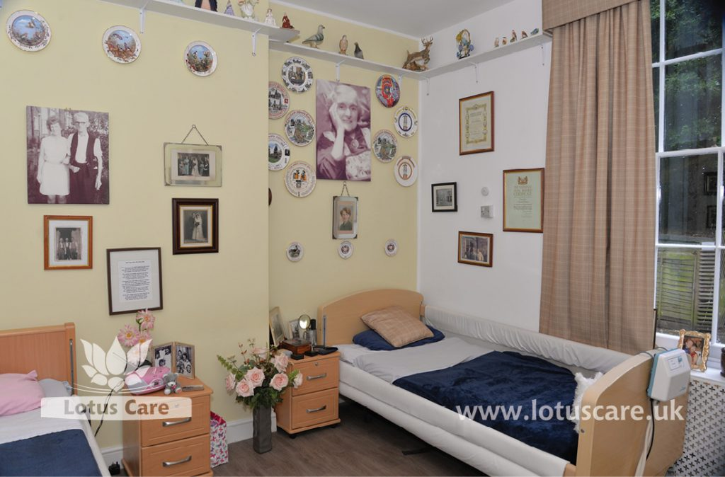 Lots of photos in a coupe's room at The Villa Care Home, making it like their previous bedroom.